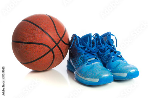 Basketball with blue basketball shoes on white