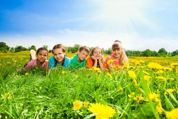 Kids in a row in flower field