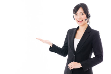 young asian businesswoman with headset showing