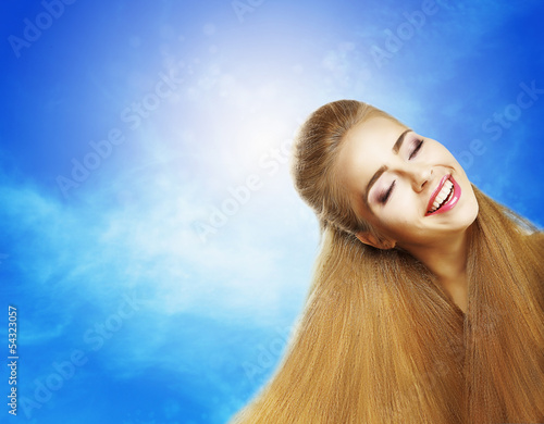 Positive Emotions. Laughing Teen Girl on Blue Sky. Jubilance