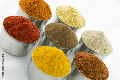 Spices in silver jars, isolated on white background