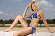 beautiful blonde woman in blue bikini