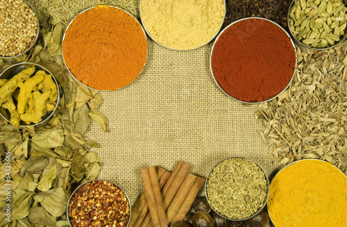 Herbs and spices on hessian background