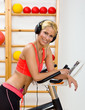 woman in gym with headphones