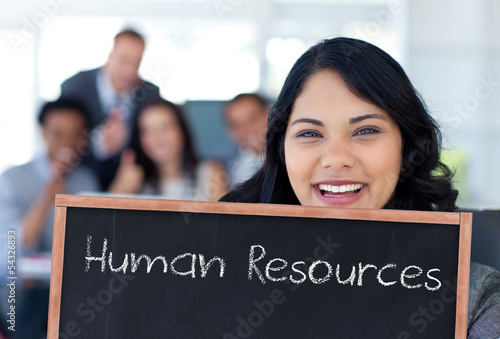 Businesswoman holding a blackboard
