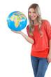 Woman presenting a globe