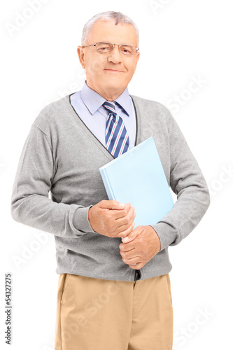 Smiling senior man holding a book