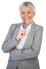 Smiling businesswoman holding pen