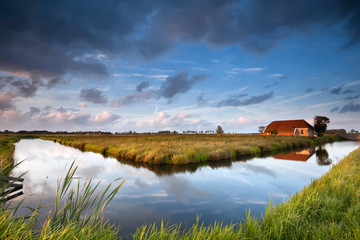 river and charming farmhouse