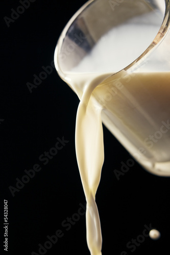 Milk pours out of the cup
