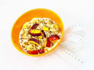 Plate with healthy breakfast and measurement