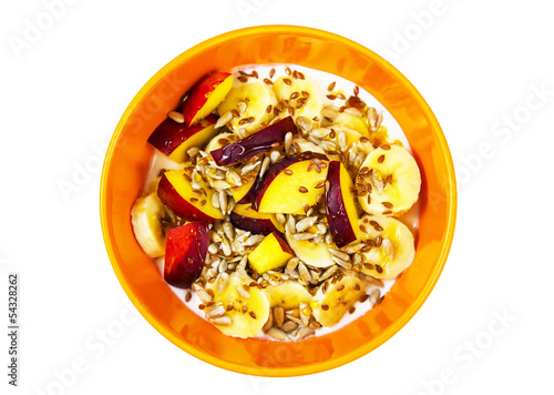 Orange plate with peach, banana, seeds and yougurt