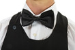 young waiter in work uniformon the white
