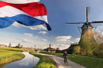 Windmills with flag of Holland in Zaanse Schans