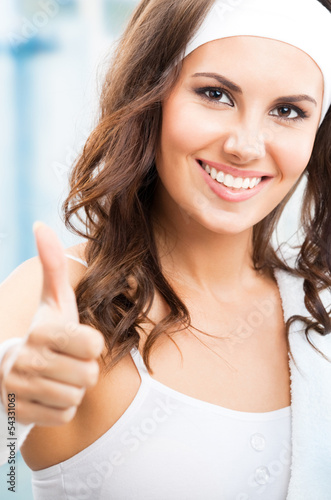 Woman showing thumbs up gesture