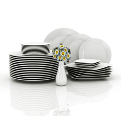 empty plates and glasses on white background