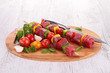 board with raw beef and vegetable kebab