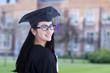 Beautiful female graduate on campus