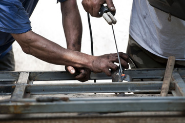 Close up portrait of laborer working on construction
