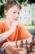 Thinking Boy in a Chess Game