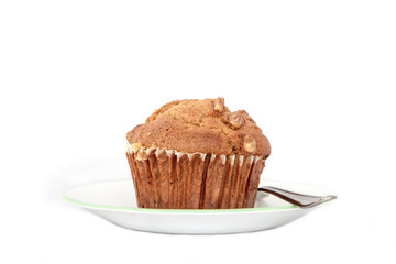 Isolated nut muffin in a plate