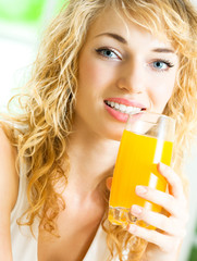 Happy woman drinking juice