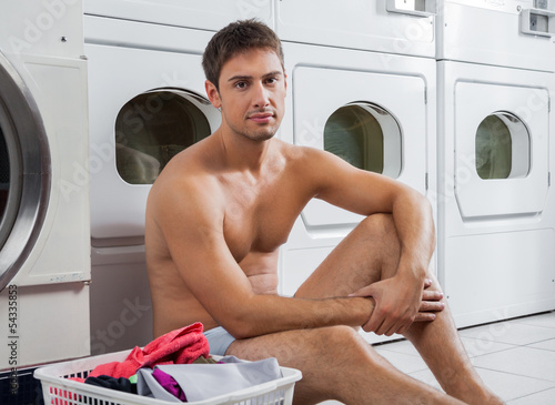 Semi Nude Man With Laundry Basket