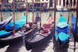Venice seafront with gondolas on the waves