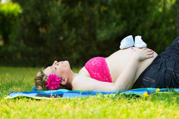 Pregnant woman on the grass