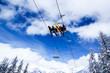 Ski lift against blue sky