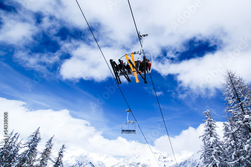 Ski lift against blue sky