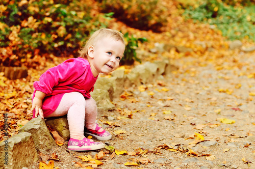 toddler girl in fall park