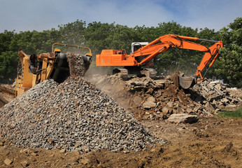 Stone crusher and crane in working