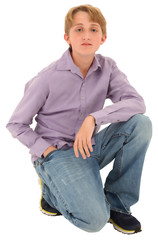 Handsome casual Caucasian teen boy over white background.