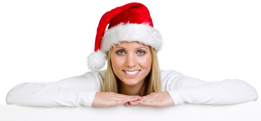woman with christmas hat shows a sign