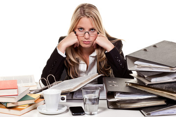 stressed woman in front of a desk