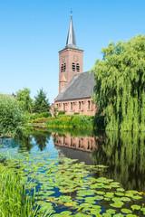 Church reflected in the Dutch river