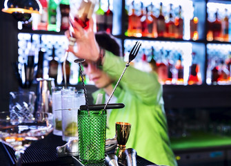 Barman professional making cocktail