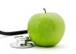 Apfel mit Stethoskop / Gesundheit