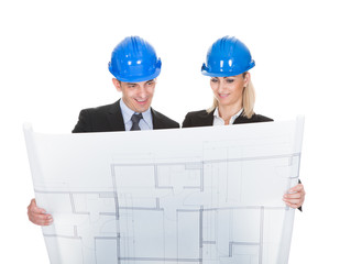Two Architects Looking At Blueprint