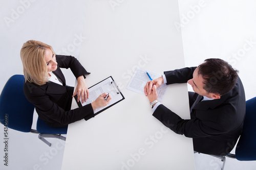 Two Businesspeople Talking With Each Other