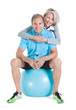 Mature Couple On Pilates Ball