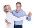 Portrait Of Mature Couple Dancing