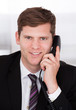 Businessman talking on telephone
