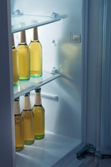 Alcoholic bottles arrange in refrigerator