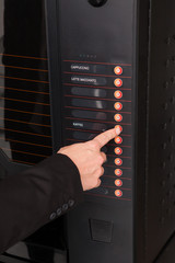 Hand pressing button of vending machine for coffee