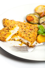 Fish dish. Fried fish fillet with vegetables