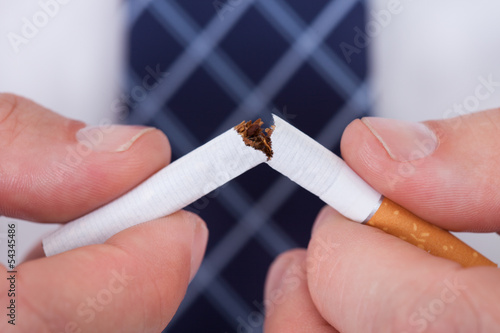 Man Hand Breaking Cigarette