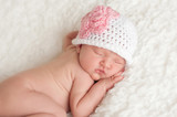 Newborn Baby Girl Wearing a Crocheted Hat