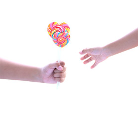 Lollipop in hand isolated on white with clipping path